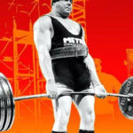Man powerlifting on a deadlift bar with Eleiko plates in competition