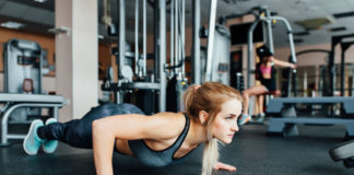 Girl Doing Pushups Concerned About Symtoms of Overtrainning and Overreaching
