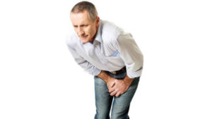 Man grips his groin in pain after learning of male sports hernia symptoms