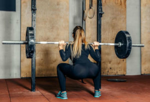 powerlifter uses the best rep range for mass on squats and the best rep range for strength on upper body