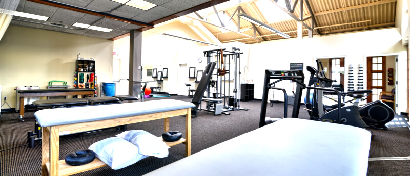 Treatment center filled with physical therapy equipment and other rehabilitation devices