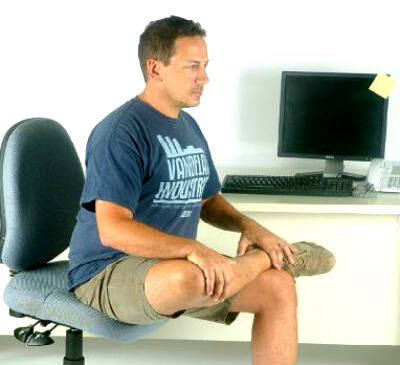seated hip stretch done just prior to performing psoas muscle pain exercises for lasting relief