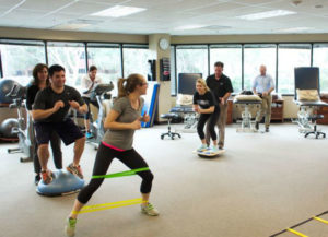 physical therapy patients perform sports hernia rehabilitation with strengthening exercises