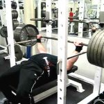 High pin press being performed on the bench press