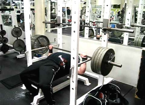 Low pin press performed on the bench press