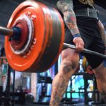 Powerlifting gear and equipment being used during deadlifts by an elite strength athlete