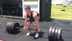 Novice lifter completing deadlifts during the initial stages of a beginner powerlifting program