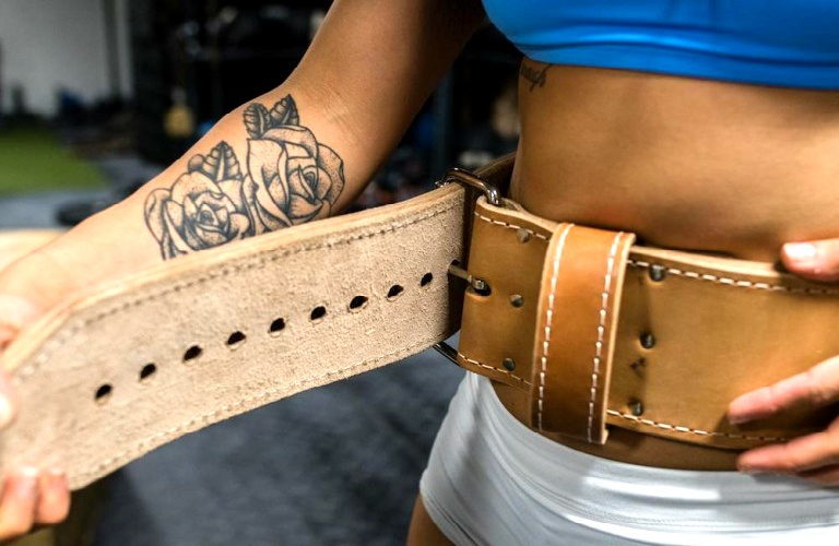 Powerlifting Belt Worn By A Female Powerlifter Before Completing Deadlifts