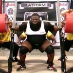 Elite strength athlete Ray Williams Squats 1,005 pounds to set a new world record while wearing red and black SBD powerlifting knee sleeves