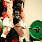 Deadlift workout program completed by powerlifter in SBD singlet