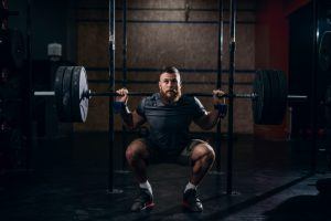 Powerlifter performs squats as part of the Madcow 5x5 Workout on Monday